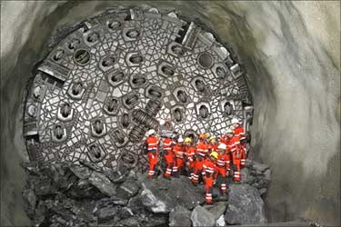 Miners stand in front of the gaby drill.