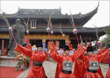 Performers in traditional costumes at a Confucian temple in Nanjing.