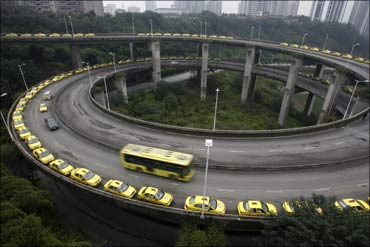 Taxis line up to get their tanks filled on a viaduct in Chongqing municipality.