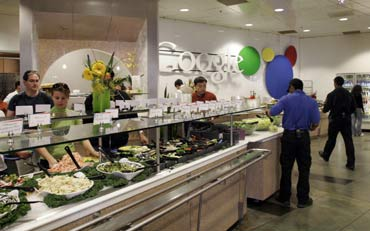 Employees choose their free lunch from one of fifteen different cafes at Google headquarters in Mountain View, California.