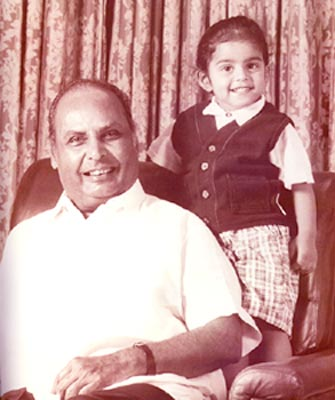 Dhirubhai Ambani with his grandson.