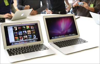Media and guests check out Apple's latest MacBook Air models and new operating system.