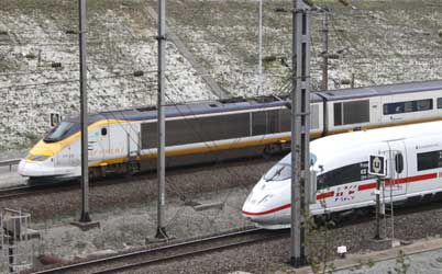 An Eurostar passes a Deutsche Bahn ICE 3 high speed train leaving the Channel Tunnel.