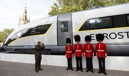 Four members of the Scot's Guards pose next to a new Eurostar train.