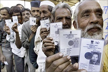 Indian citizens with their identity card.
