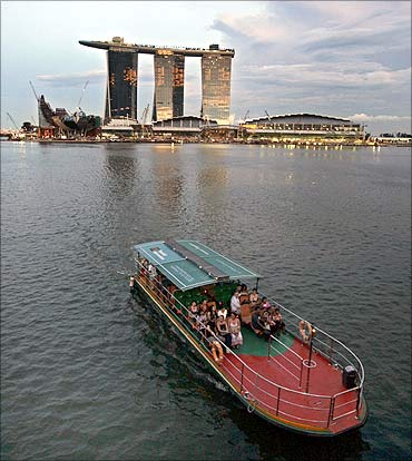 A tourist boat passes Marina Bay Sands casino in Singapore.
