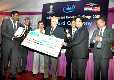 HRD Minister Kapil Sibal presents India Innovation Pioneers' Challenge award to Kranthi.