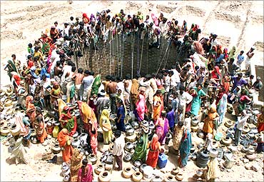 People gather to get water from a huge well in the village of Natwarghad, Gujarat .