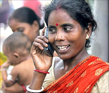 Tulsi Prasad, an Indian slum dweller, uses a mobile phone.