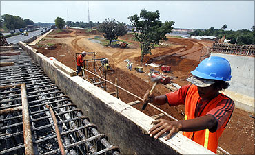 Workers construct a new toll road at Jakarta.