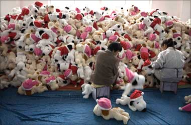 Workers perform a quality check in a toy factory in the suburbs of Shanghai.