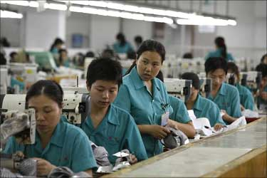 Workers at a production line of a shoe factory in China's southern province of Guangdong.