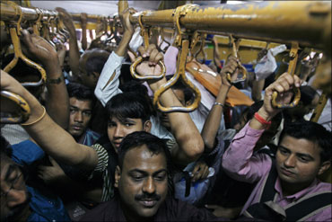 Commuters packed like sardines in a Mumbai local train.