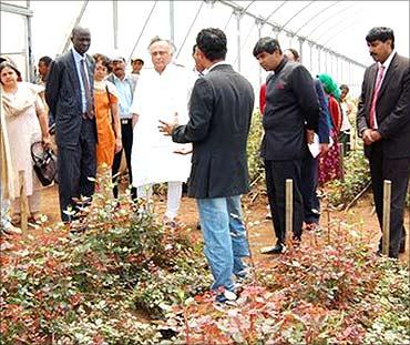 Environment Minister Jairam Ramesh visits a farm.