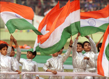 Indian children waving the Tricolour.