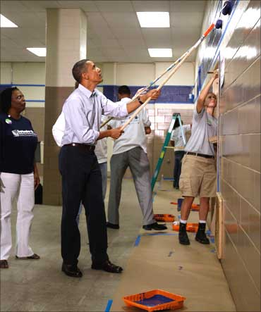 Barack Obama volunteers to paint at National Day of Service and Remembrance event in Washington.