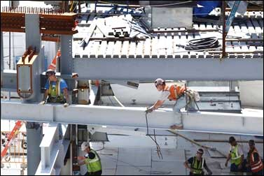Construction workers work on beams at the World Trade Center construction site in New York.