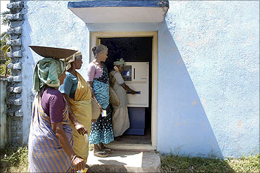 Villagers use the ATM.