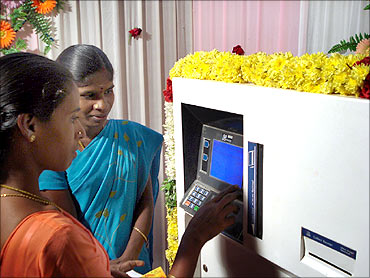 Villagers use an ATM.