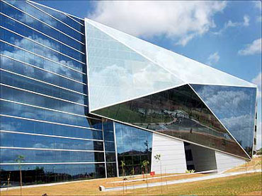 Futuristic office buildings at the Infosys campus in Mysore.