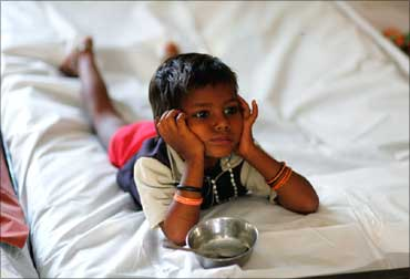 A malnourished child waits for food at the Nutritional Rehabilitation Centre in Madhya Pradesh.