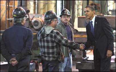 Obama greets workers.