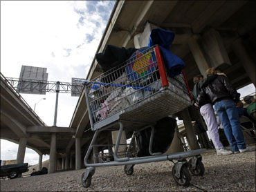 A shopping cart with a homeless person's belongings is seen under an overpass in Waco, Texas.
