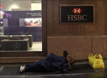 A homeless man sleeps in front of an HSBC branch in New York.