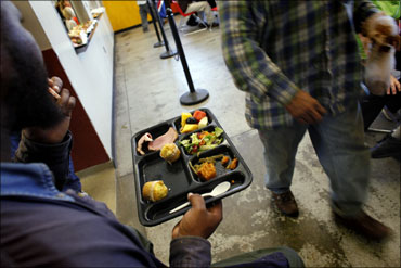 A homeless man holds his plate of food at the Urban Ministry soup kitchen in Charlotte, North Carolina.