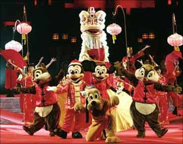 Disney's cartoon characters perform with lion dancers at Hong Kong Disneyland.