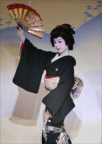 A geisha performs at the Kaburenjo theatre in the Miyagawa district of Kyoto, Japan.