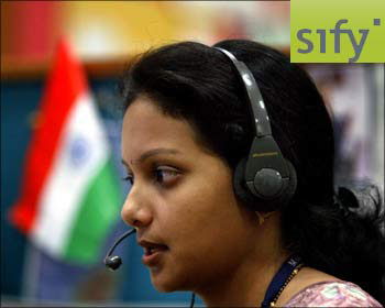 An employee at an BPO unit in Mumbai. (Inset) Sify logo.