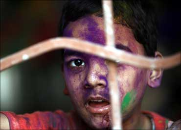 A child suffering from cerebral palsy after celebrating Holi, the festival of colours.