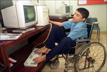 Dipak Ghosh, 15, uses his feet to operate a computer in Kolkata.