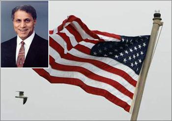 (Inset) Romesh Wadhwani. The American flag flutters.