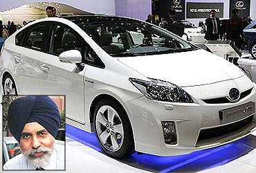 A Toyota Prius 3 is displayed at the 79th Geneva Car Show at the Palexpo. (Inset) Sandeep Singh.