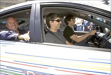 Larry Page and Sergey Brin in a RechargeIT car.