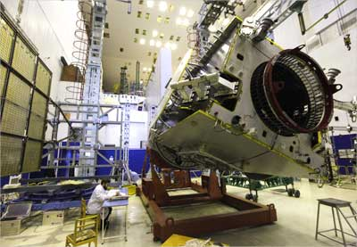 A specialist works on the Indonesian TELKOM-3 space telecommunication satellite.