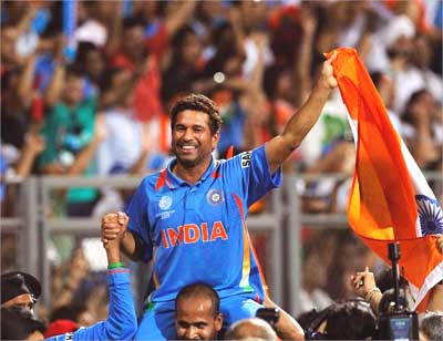 Sachin Tendulkar is carried by his teammate Yusuf Pathan.