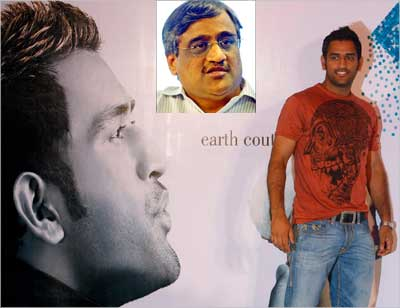 Dhoni poses during the Kolkata Fashion Week in 2009. Inset: Kishore Biyani.