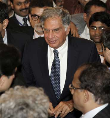 Ratan Tata (C), chairman of the Tata Group, surrounded by the media.