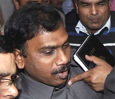 Andimuthu Raja (C) leaves the court after his hearing in New Delhi February 10, 2011.