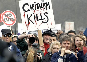 Demonstrators attend a rally in Hyde Park, during a protest organised by the Trades Union Congress.