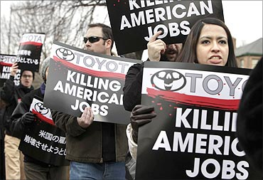 United Auto Workers (UAW) activists protest against Toyota outside the Japanese Embassy.