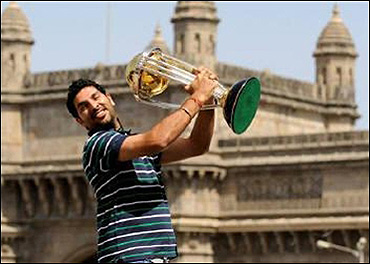Yuvraj Singh holds the World Cup trophy.