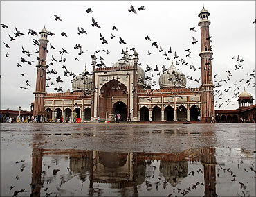 Pigeons fly inside the Jama Masjid (Grand Mosque) in Delhi.