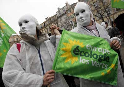 Members of the French Europe Ecologie-Les Verts Green Party participate in a protest.