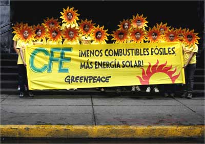 Greenpeace activists take part in a protest against the use of fossil fuels in Mexico City.