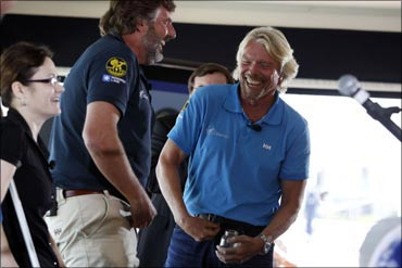 Richard Branson (R) enjoys a moment with Chris Welch.