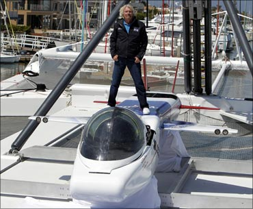 Branson poses on top of the solo-piloted submarine.